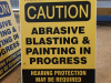 caution blasting sandwich board sign