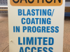 caution blasting coating sandwich board sign