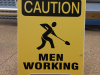 caution men working sandwich board sign